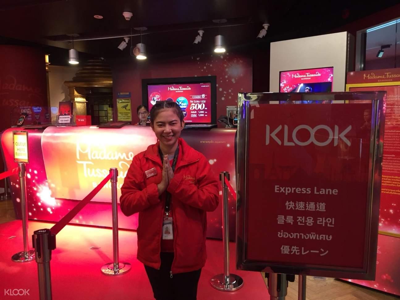 madame tussaud staff infront of klook express lane